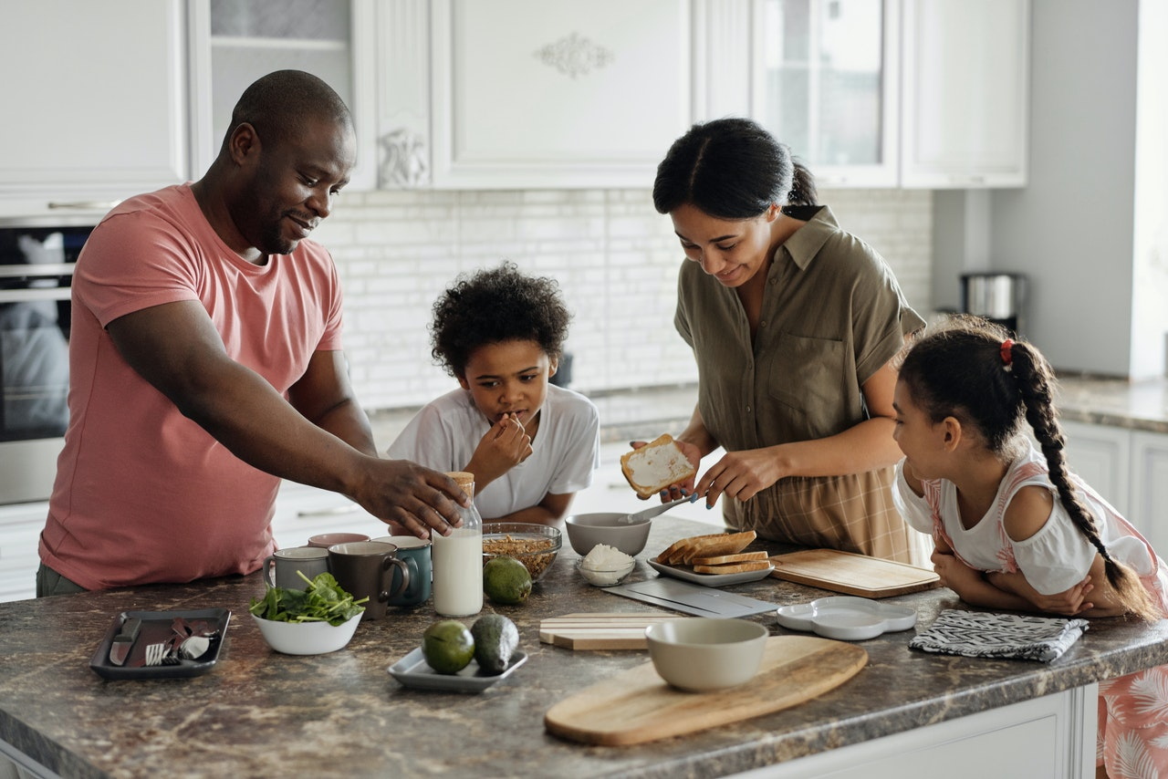 man in the kitchen with his family