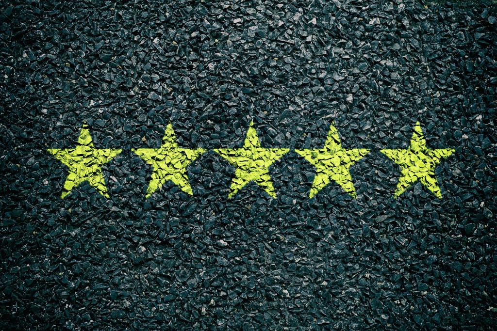 5 yellow stars drawn on concrete